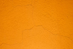 Orange cracked plaster wall Stock Photography
