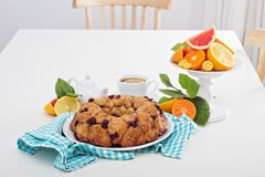 Orange and cranberry monkey bread. On white table Stock Images