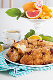Orange and cranberry monkey bread. On white table Royalty Free Stock Image