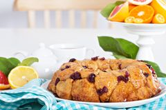 Orange and cranberry monkey bread. On white table Royalty Free Stock Images