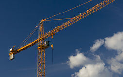 Orange Crane with clouds Royalty Free Stock Photo