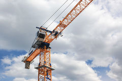 Orange Crane In Front Of Sky and Clouds Royalty Free Stock Image