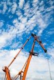 Orange crane in port close-up shot Stock Images