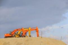Orange cranes Stock Image