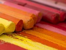 Orange crayons background Stock Photo