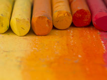 Orange crayons background Royalty Free Stock Image