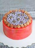 Orange cream cheese cake with raspberry, bilberry and blackberry. An orange cream cheese cake with raspberry, bilberry and blackberry Stock Images