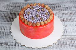 Orange cream cheese cake with raspberry, bilberry and blackberry. An orange cream cheese cake with raspberry, bilberry and blackberry Royalty Free Stock Image