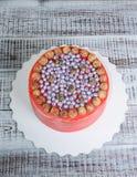 Orange cream cheese cake with raspberry, bilberry and blackberry. An orange cream cheese cake with raspberry, bilberry and blackberry Royalty Free Stock Photo