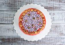Orange cream cheese cake with raspberry, bilberry and blackberry. An orange cream cheese cake with raspberry, bilberry and blackberry Royalty Free Stock Photos