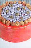 Orange cream cheese cake with raspberry, bilberry and blackberry. An orange cream cheese cake with raspberry, bilberry and blackberry Stock Image