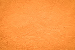 Orange creased tissue paper background Stock Photos