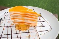 Orange crepe cake. Orange cake Close up Stock Photos