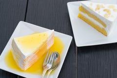 Orange crepe cake in white dish on black wooden table.  royalty free stock photo