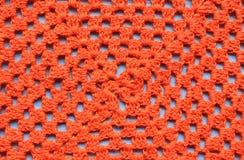 Orange crochet napkin. Bright orange crochet napkin texture Royalty Free Stock Image