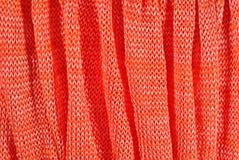 Orange crumpled stockinet background Stock Images