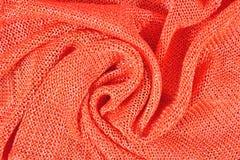Orange crumpled stockinet background Stock Photography