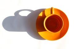 Orange cup. One orange cup on white background Stock Photos