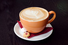 Orange cup of coffe Royalty Free Stock Image