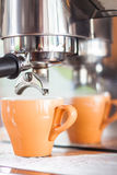 Orange cup of coffee for espresso Royalty Free Stock Photo