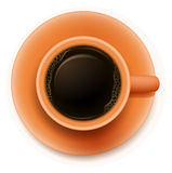 An orange cup with a coffee Royalty Free Stock Photography