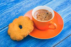 orange cup of coffee witt tasty cookie Stock Photography