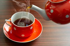 Free Orange Cup Of Tea And Teapot On Wooden Background. Hot Morning Drink And Steam From The Tea. Home Tea Time Concept Stock Image - 164735541