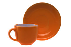 Orange cup and saucer Royalty Free Stock Photography
