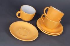 Orange cup and saucer Stock Photos
