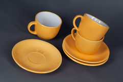 Orange cup and saucer Royalty Free Stock Photo