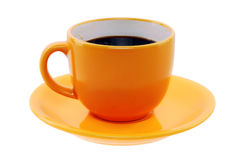 Orange cup and saucer Stock Images