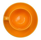 Orange cup with saucer Royalty Free Stock Image