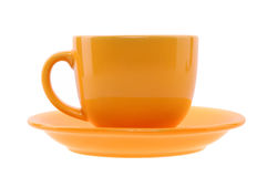 Orange cup and saucer Royalty Free Stock Images