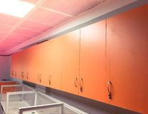 Orange cupboards in an office. With white tables and sections for desktop computers and office work royalty free stock photos