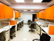 Orange cupboards in an office stock image