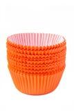 Orange cupcake. Baking cups on white Stock Image