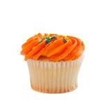 Orange Cupcake with sprinkles on white Royalty Free Stock Photos