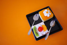 Orange cupcakes and cream. On the table Stock Images