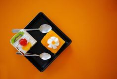 Orange cupcakes and cream. On the table Stock Photography