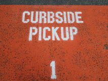 Free Orange Curbside Pickup Sign On Asphalt Or Ground With The Number 1 Royalty Free Stock Images - 209794409