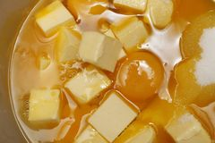Orange curd. Egg, butter and sugar in bowl to make orange curd Stock Photography