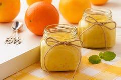 Orange curd english citrus cream in glass jars. Royalty Free Stock Photography