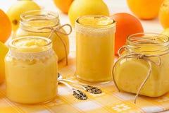 Orange curd and lemon curd english citrus cream in glass jars. Stock Image