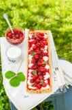 Orange Curd Tart with Vanilla Strawberries Stock Photo