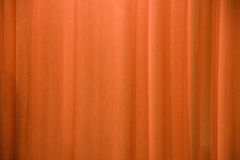 Orange curtain background Stock Image