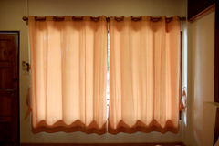 Orange curtain and window. Royalty Free Stock Image