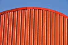 Orange curved roof. Royalty Free Stock Photo