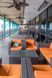 Orange Cushions on Brown Rattan Furniture Royalty Free Stock Images