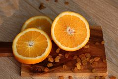 The orange cut on a Board Stock Photography