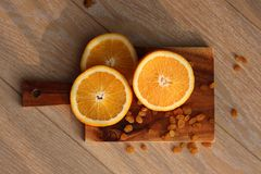 The orange cut on a Board Stock Image